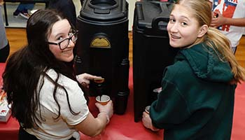 students pouring hot chocolate